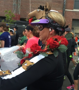 Runner dressed as a jockey (note the googles and horse on top of her head plus a rose garland around her neck)
