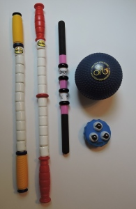 (left to right) the Marathon Stick, the Hybrid Stick, the RangeRoller Pro, the Orb Massage Ball, Addaday Marble Massage Roller