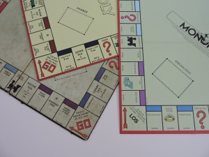 Monopoly game boards (L to R) - the original, UK edition, and German edition