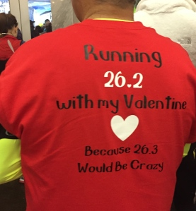 One couple wore matching shirts with a Valentine's Day theme