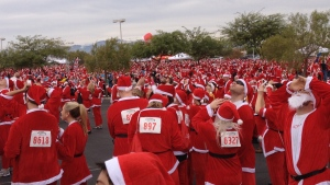 Trying to break the record for the most runners dressed as Santa at the 2012 Las Vegas Great Santa Run