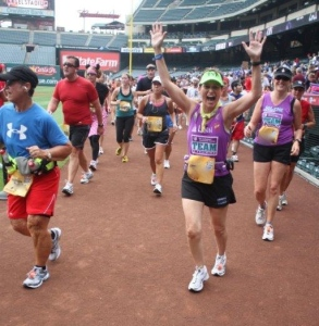 Running down the warning track in Anaheim Stadium